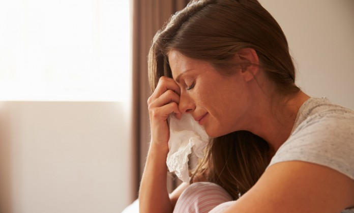 1449554714_woman-crying-tissue-1000x600-696x418[1]